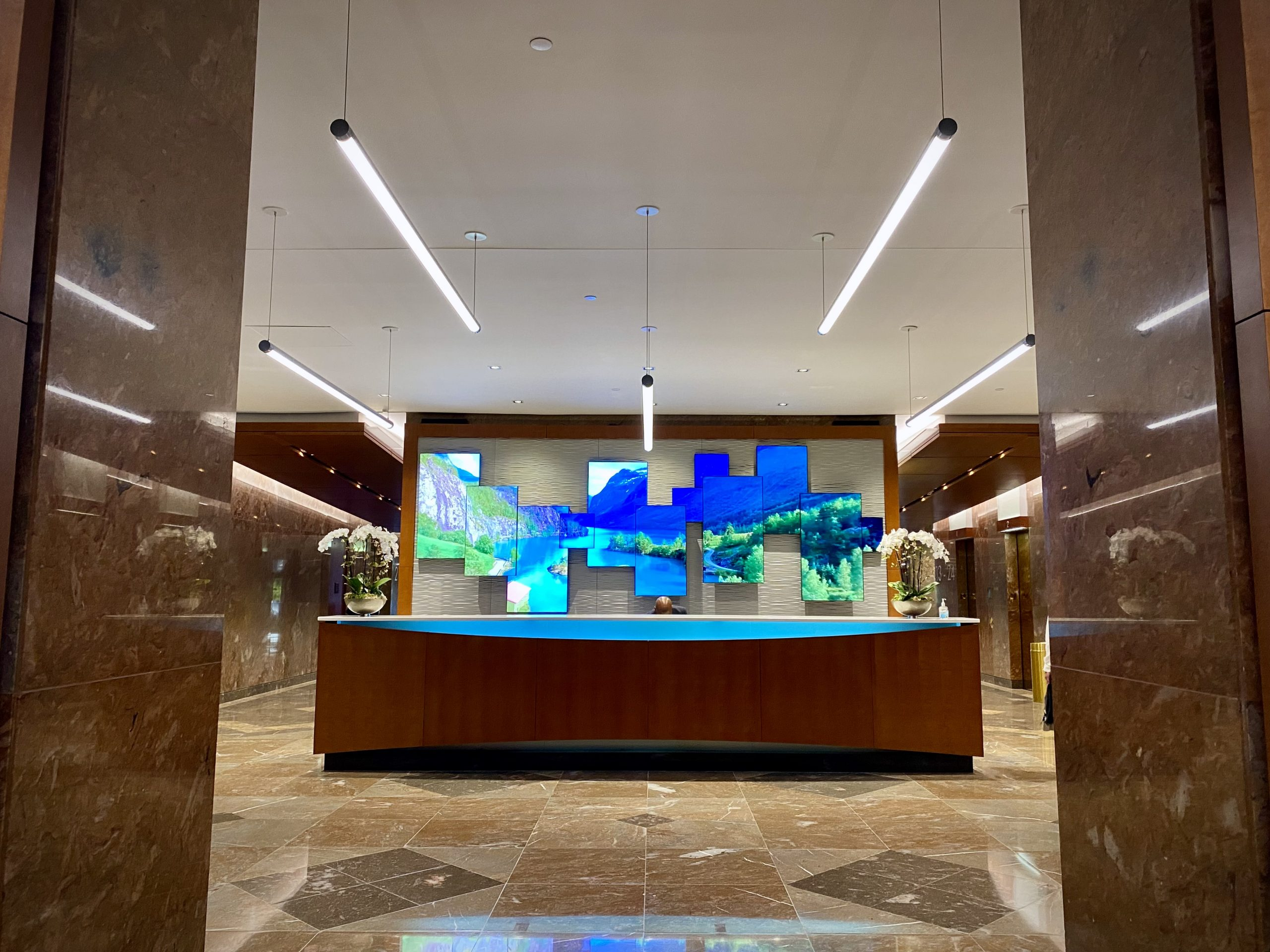 Interior Lobby front desk and custom millwork in Norfolk Dominion Tower 1st floor
