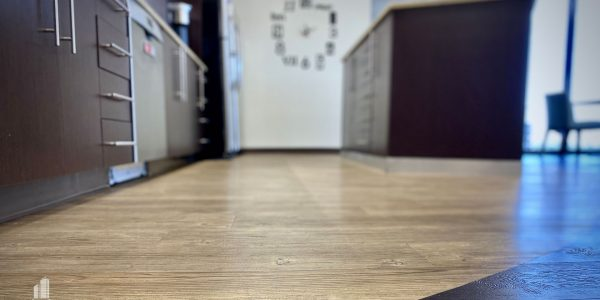 Radius plank flooring and custom millwork in break room in Norfolk Dominion Tower 10th floor