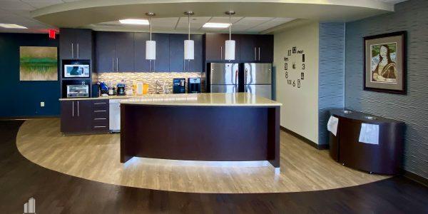 custom millwork and radius flooring in kitchen of break room in Norfolk Dominion Tower 10th floor