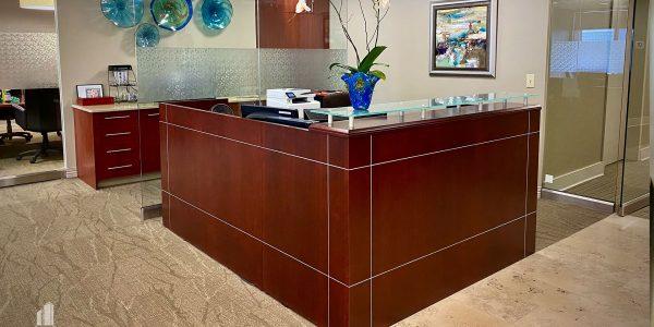 Custom wood front desk at Palladium in Norfolk Dominion Tower 10th Floor