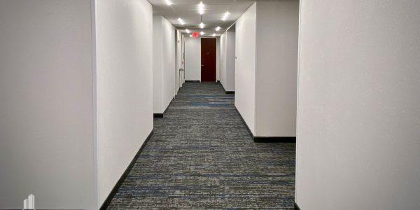 Interior hallway corridor and t-bar LED lighting in Norfolk Dominion Tower 13th floor