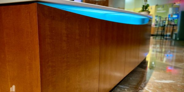 Custom wooden front desk with radius curve in Norfolk Dominion Tower 1st floor lobby