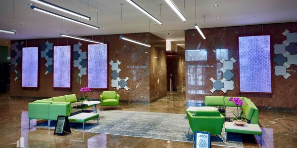 Custom millwork and LED panels in Norfolk Dominion Tower 1st floor lobby