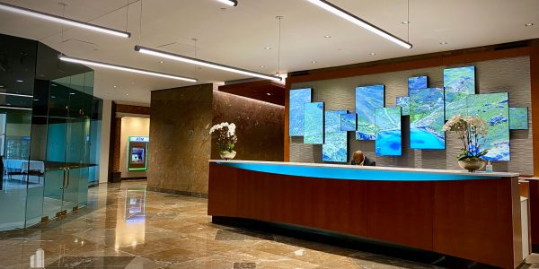custom millwork front desk and LED panels in Norfolk Dominion Tower 1st floor lobby