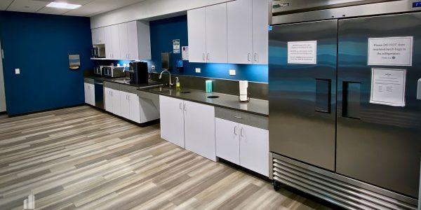 custom millwork in break room and kitchen in Norfolk Dominion Tower 20th floor