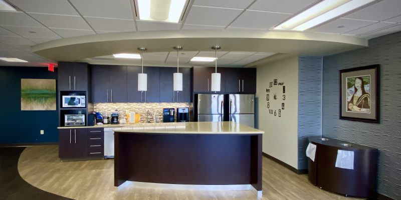 Break room and kitchen area and custom millwork at Palladium in Norfolk Dominion Tower 10th floor