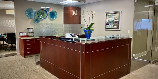 Custom wood receptionist desk at Palladium in Norfolk Dominion Tower 10th Floor