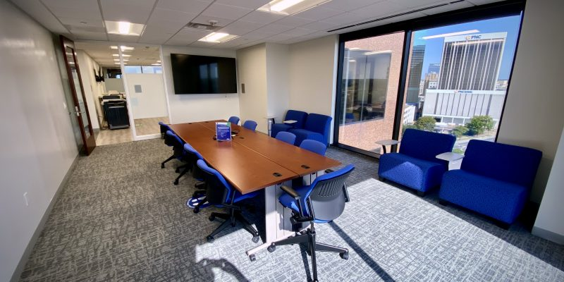 Conference room table and blue chairs in 9th Floor of Dominion Tower overlooking Downtown Norfolk