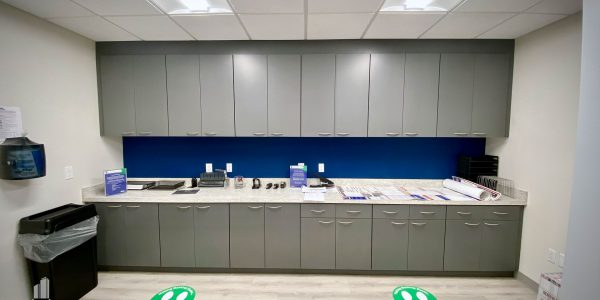Custom gray storage cabinets and counter in bank office in Norfolk Dominion Tower