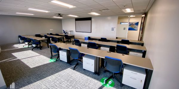Classroom with three rows of chairs and tables on each side of room in Norfolk Dominion Tower