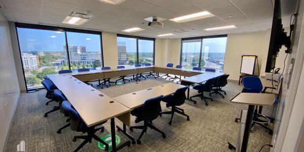 Classroom with tables and chairs in a square overlooking Downtown Norfolk
