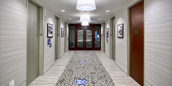 Elevator lobby with gray carpet and walls on the 9th floor of the Norfolk Dominion Tower