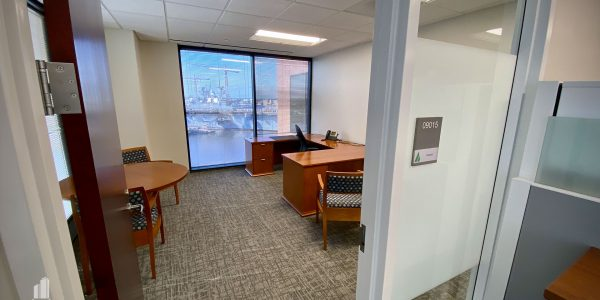 Office with desk and table and frosted glass side light window