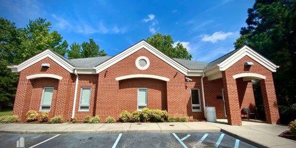 Front exterior of small brick medical building in Hampton
