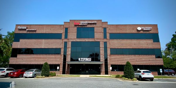 Front exterior of three-story corporate brick building on Volvo Parkway in Chesapeake