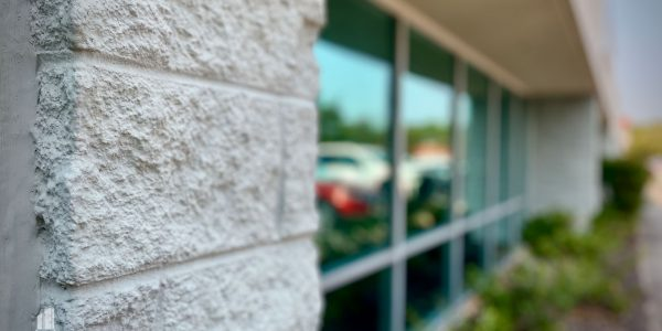 Brick and storefront glass of office complex on Volvo Parkway in Chesapeake