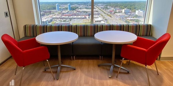 High rise office seating area overlooking the city of Virginia Beach