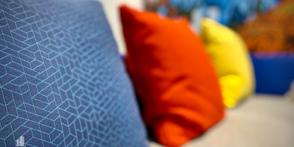 Colorful pillows on employee lounge couch