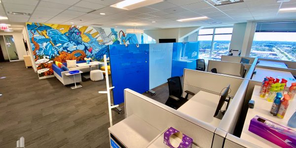 Office cubicles nearby employee lounge