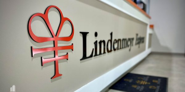 Lindenmeyr Munroe logo on the front of the receptionist desk